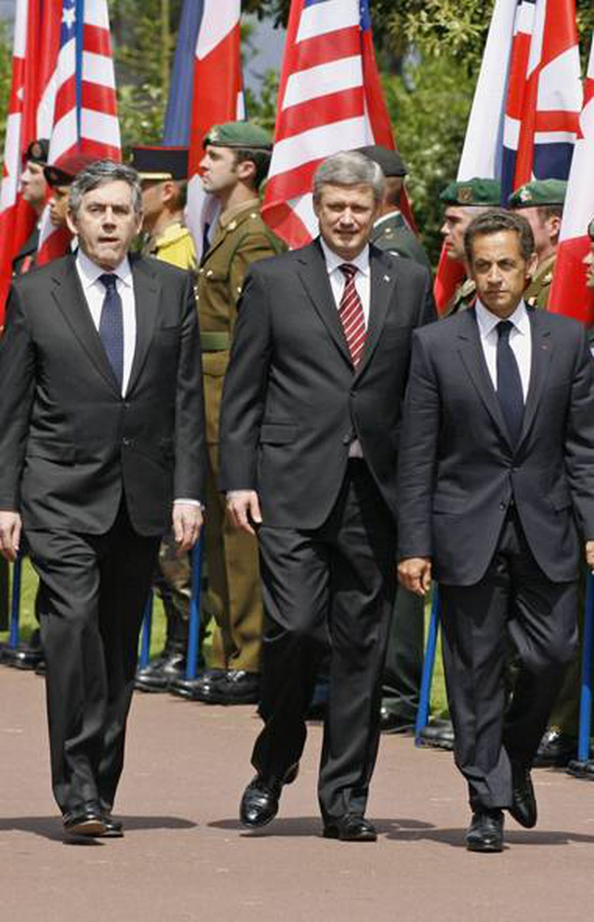 "FRANCE/CANADA/BRITAIN: French President Nicolas Sarkozy invited Prime Minister Stephen Harper to France's 2009 D-Day memorial because he felt sympathy for Mr. Harper's political troubles, according to a June 8, 2009, cable. French official Jean-David Levitte says Mr. Sarkozy invited Mr. Harper and Britain's then-prime minister, Gordon Brown, because of political need. ""The cases of the UK and Canada were exceptional, he added, because both Gordon Brown and Stephen Harper were in such political trouble at home that the survival of their governments was at stake,"" the cable records Mr. Levitte as explaining."