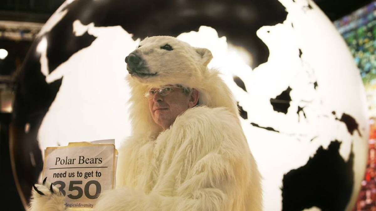 An activist dressed as a polar bear holds a sign urging nations at the Copenhagen climate summit to agree to limit carbon in the atmosphere to 350 parts per million, the level many scientists believe is the maximum that can be sustained without triggering catastrophic warming. Heribert Proepper/AP