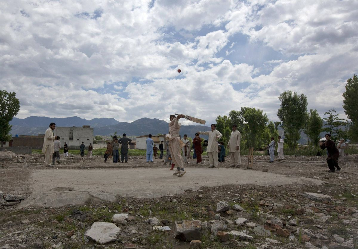Children play cricket on the demolished site of a compound where Osama bin Laden was found in Abbottabad May 1, 2012. Al Qaeda leader bin Laden was killed almost a year ago, on May 2, 2011, by a United States special operations military unit in a raid on his compound in Abbottabad.