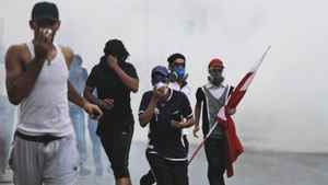 Bahraini anti-government protesters react to tear gas fired by riot police on Thursday, Apr. 12 in Bilad Al Qadeem, Bahrain, on the edge of the capital of Manama.