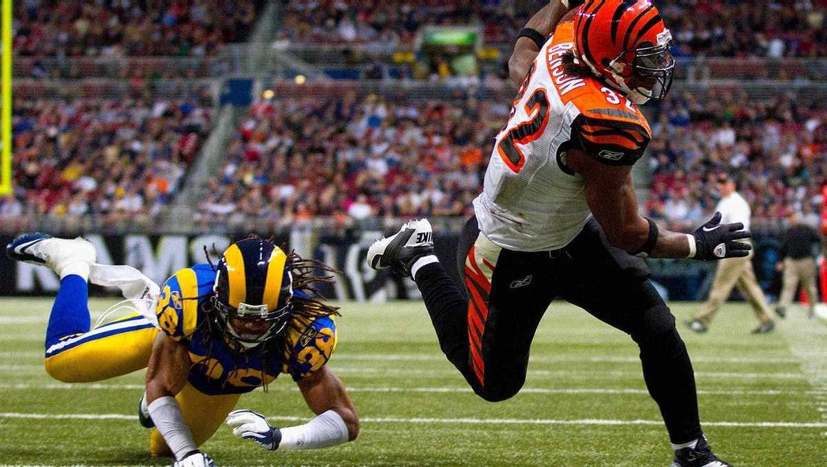 Cedric Benson #32 of the Cincinnati Bengals scores a touchdown against Josh Gordy #38 of the St. Louis Rams at the Edward Jones Dome on December 18, 2011 in St. Louis, Missouri. The Bengals beat the Rams 20-13. (Photo by Dilip Vishwanat/Getty Images)