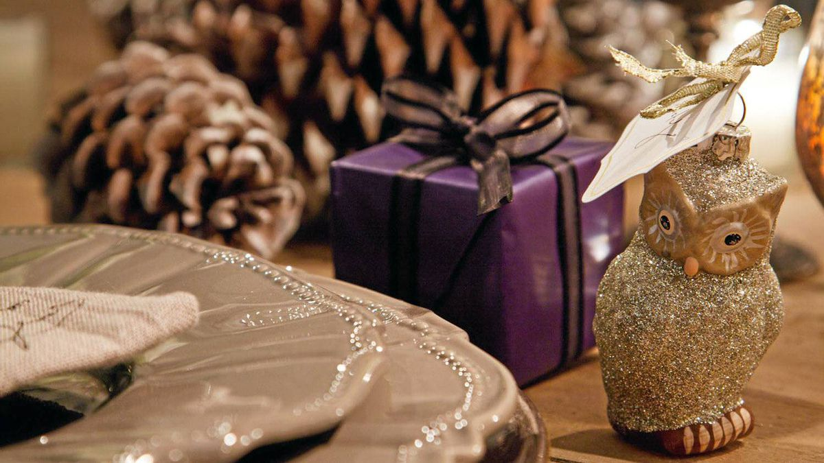 Instead of Christmas crackers, small individual presents were chosen - one fine truffle wrapped in a box with dark blue paper and ribbons.