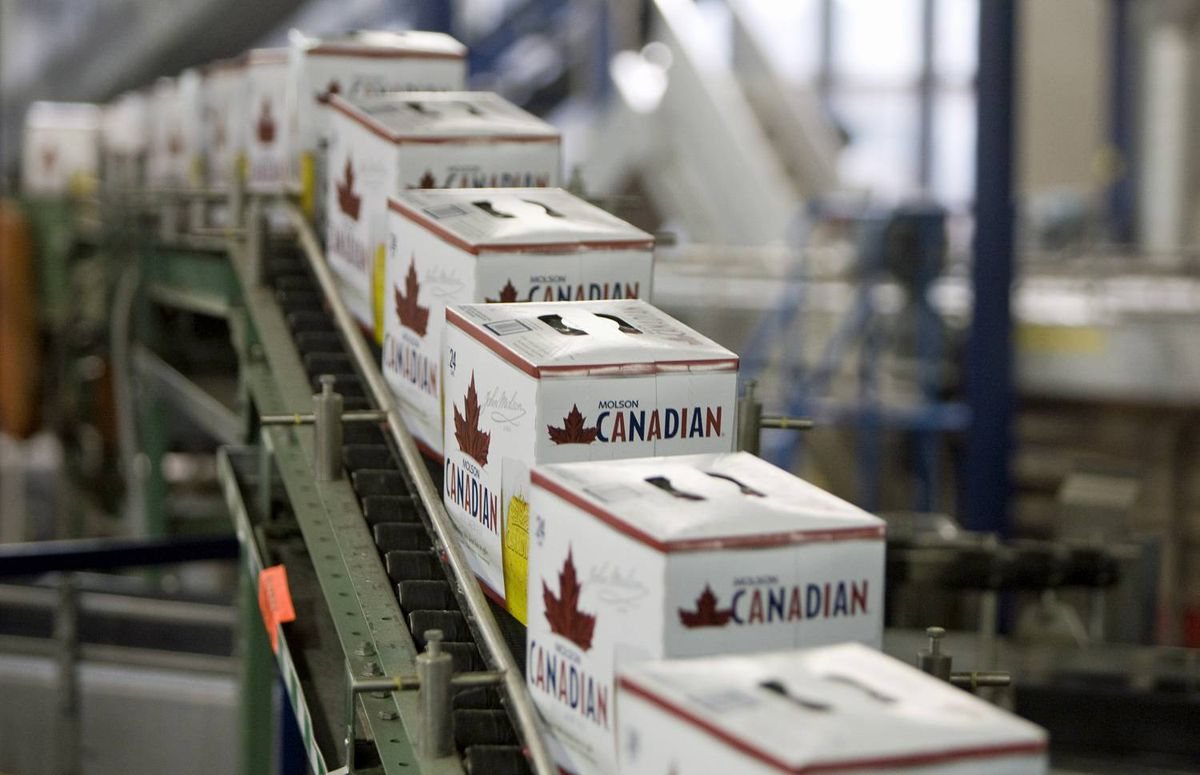 Cases of Molson Canadian roll of the brewery line in Vancouver on Jan. 26, 2010.