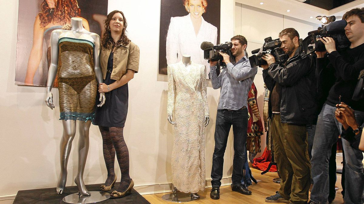 Charlotte Todd stands next to the dress she designed, and which was worn by Kate Middleton during a charity fashion show in 2002.