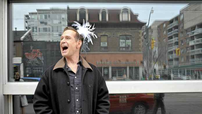 Comedian Scott Thompson wears a feather tiara after suggesting Drag Day as his big idea for Toronto, on Queen Street West, Friday April 29, 2011