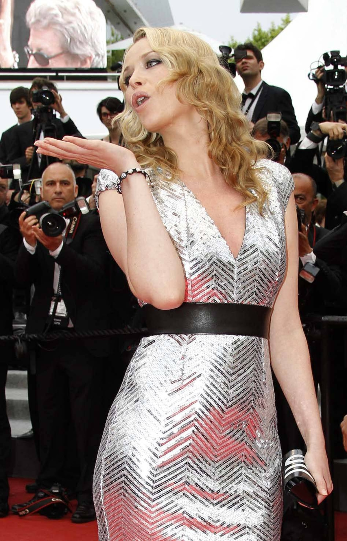 """Actress Kiera Chaplin blows a kiss on the red carpet before the screening of """"La Conquete"""" at the Cannes Film Festival in Cannes, France, on Wednesday."""