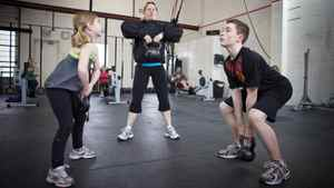 Two youngsters share a workout with trainning coach Laura MacDonald at CrossFit Gym in Calgary in early 2010