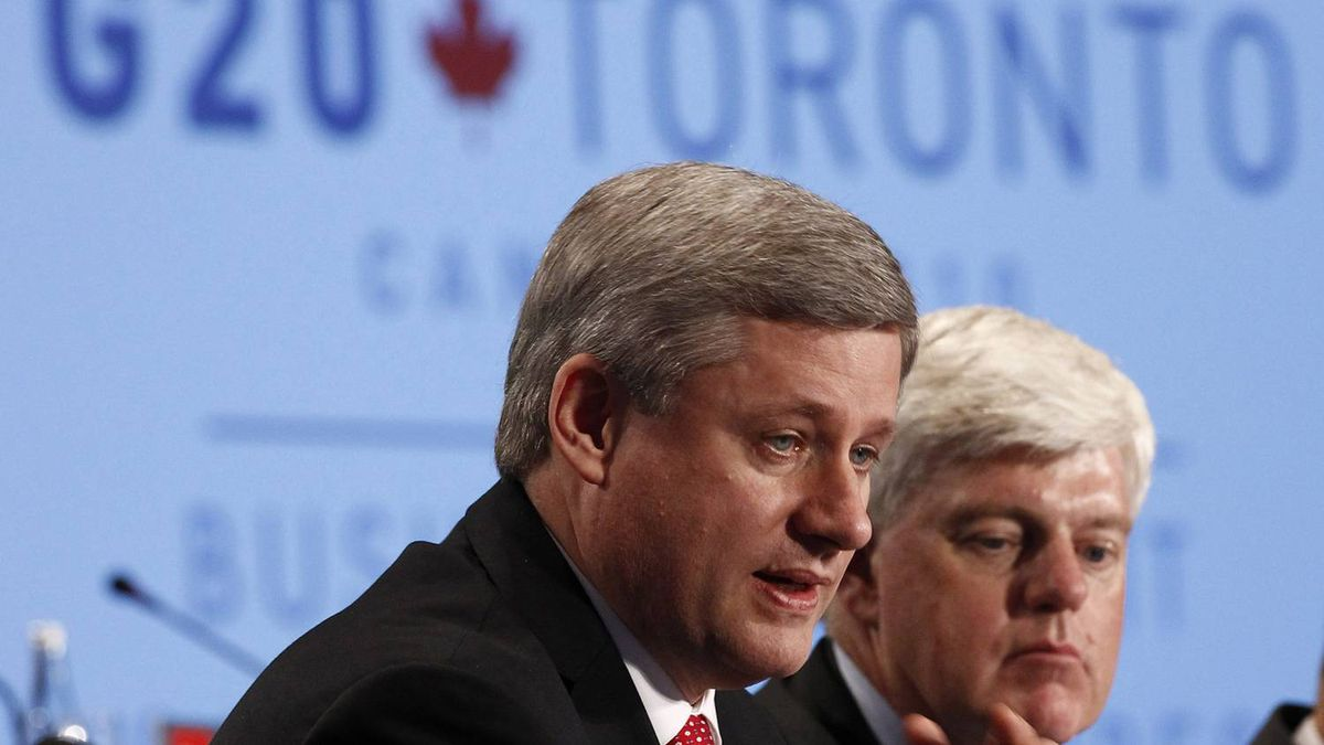 Prime Minister Stephen Harper, left, speaks during a business summit with John Manley, CEO of the Canadian Council of Chief Executives