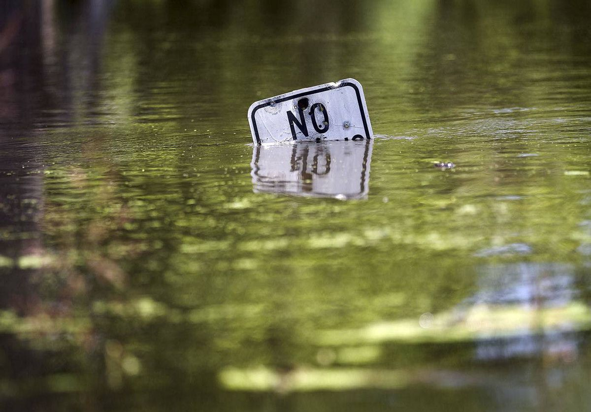 A street sign stands in the rising water of Atchafalaya River in Simmesport, Louisiana. The Morganza Spillway floodgates were opened for the first time in nearly forty years to lower the crest of the flooding Mississippi River.