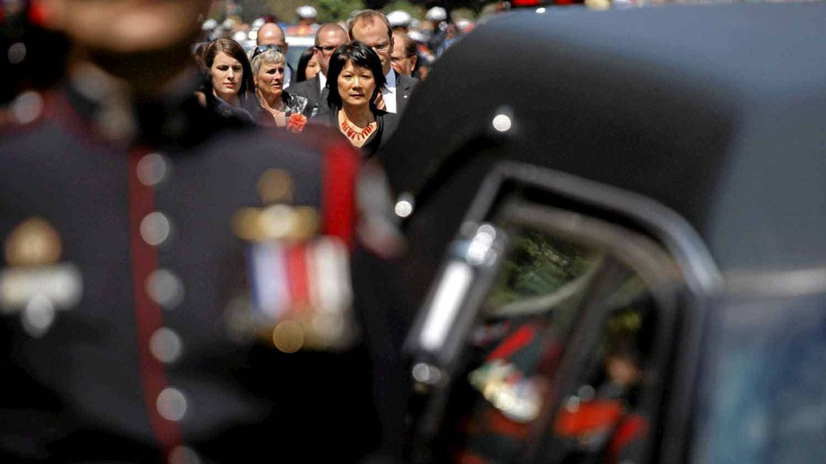 Olivia Chow follows the hearse carrying her husband, NDP Opposition Leader Jack Layton, during a procession on route to his state funeral in Toronto, August 27, 2011.