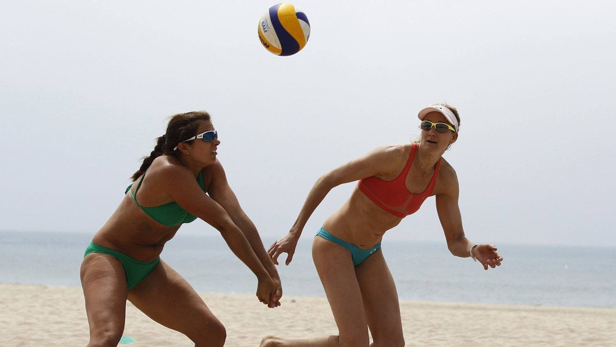 U.S. beach volleyball players Kerri Walsh (R), 33, and her partner Misty May, 34, train for the London 2012 Olympics in Manhattan Beach, California, April 9, 2012. Beach volleyball will be one of the main attractions in London, with the competition taking place at a temporary venue in Horse Guards Parade, a stone's throw from Downing Street and Buckingham Palace. No one will be more in the spotlight than Walsh and May-Treanor, who won gold medals in Athens and Beijing and are favourites for a third title in London. And, yes, the Americans will still be wearing the standard bikini uniforms — not the more modest attire approved recently by the International Volleyball Federation.