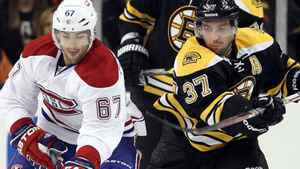 Max Pacioretty #67 of the Montreal Canadiens takes the puck as Patrice Bergeron #37 of the Boston Bruins defends on October 27, 2011 at TD Garden in Boston, Massachusetts. The Montreal Canadiens defeated the Boston Bruins 2-1. (Photo by Elsa/Getty Images)