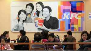People dine at a KFC outlet in Shanghai.