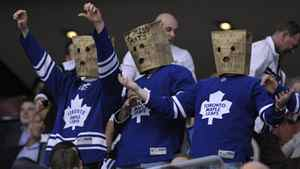 Toronto Maple Leafs fans wear paper bags on their heads during the third period of their NHL hockey game against the New York Islanders in Toronto March 20, 2012.