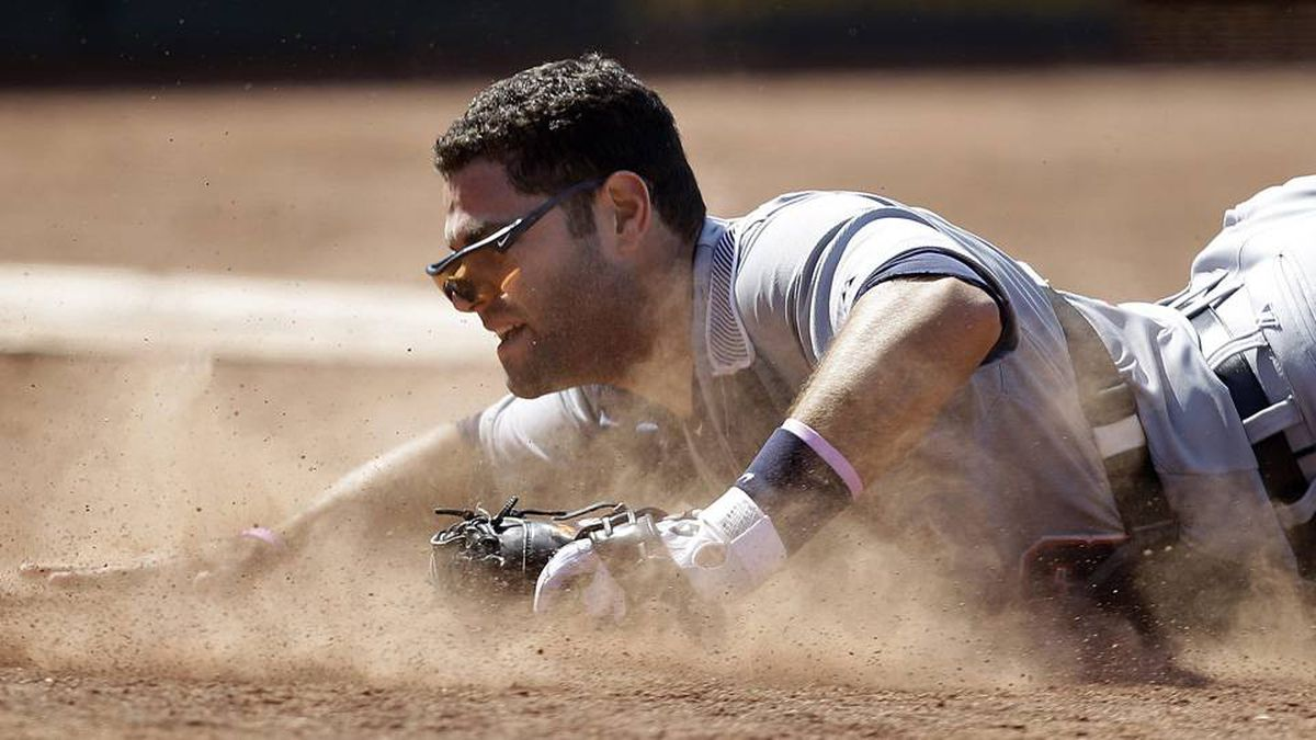 Detroit Tigers catcher Alex Avila slides but fails to make the catch on a ball hit by Oakland Athletics' Eric Sogard during the eighth inning of a baseball game Sunday.