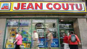 Pedestrians walk past a Jean Coutu pharmacy in Montreal.
