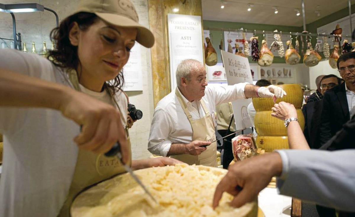 Cheese and meats are served to customers at I Salumi e I Formaggi at the Eataly opening