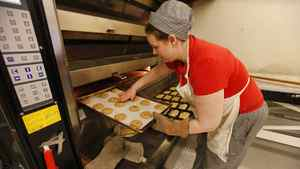 Sweets and pastry baker Stephanie Smith puts cookies in the oven at St. John's Bakery on Broadview Ave. in Toronto. The bakery is a social enterprise business owned and operated by St. John's The Compassionate Mission.