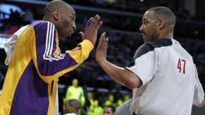 Los Angeles Lakers Kobe Bryant (L) argues with a referee after getting a technical foul during their NBA basketball game against the San Antonio Spurs in Los Angeles, California, April 12, 2011.
