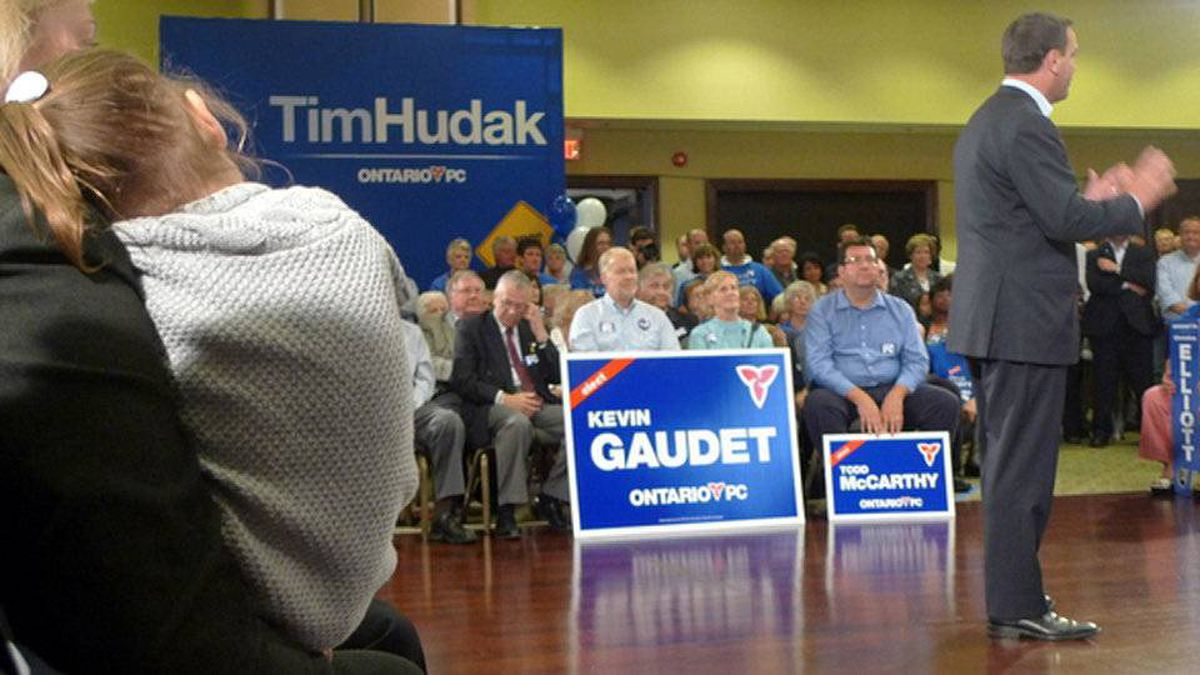 With wife Deb Hutton and daughter Miller looking on, Tim Hudak campaigns in Ajax, Ont., on Sept. 6, 2011.