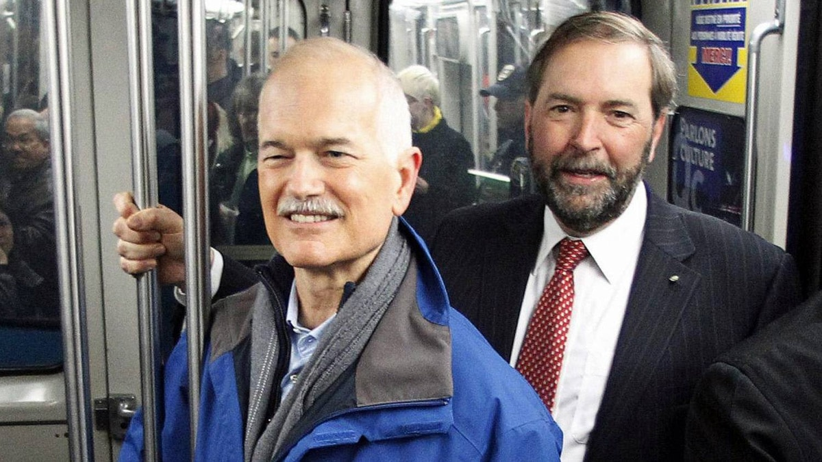 NDP Leader Jack Layton and his deputy, Thomas Mulcair, ride the Montreal metro during the federal election campaign on April 15, 2011.