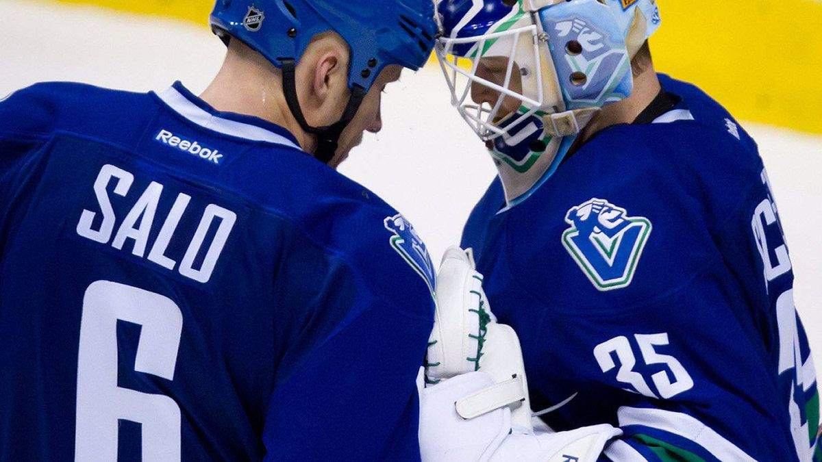 Vancouver Canucks' Sami Salo, left congratulates goalie Cory Schneider after defeating the Winnipeg Jets 3-2 during an NHL hockey game in Vancouver, B.C., on Thursday March 8, 2012. Salo re-signed with the Canucks last year, for 2-million dollars over one season.