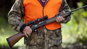 A rifle owner walks around his hunting camp in rural Ontario west of Ottawa on Sept. 15, 2010.