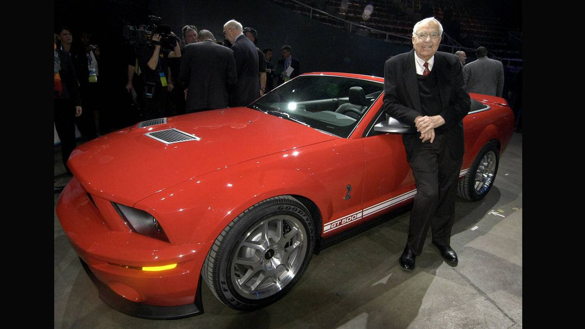 Carroll Shelby stands beside the 2007 Ford Shelby GT500 following its introduction at the North American International Auto Show in Detroit.