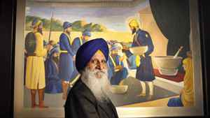 Dr. Raghbir Bains proudly displays one of many historic Sikh paintings, this one depicting the inauguration of the Khalsa brotherhood, in preparation for the opening of a new Sikh museum Oct 8, 2010.