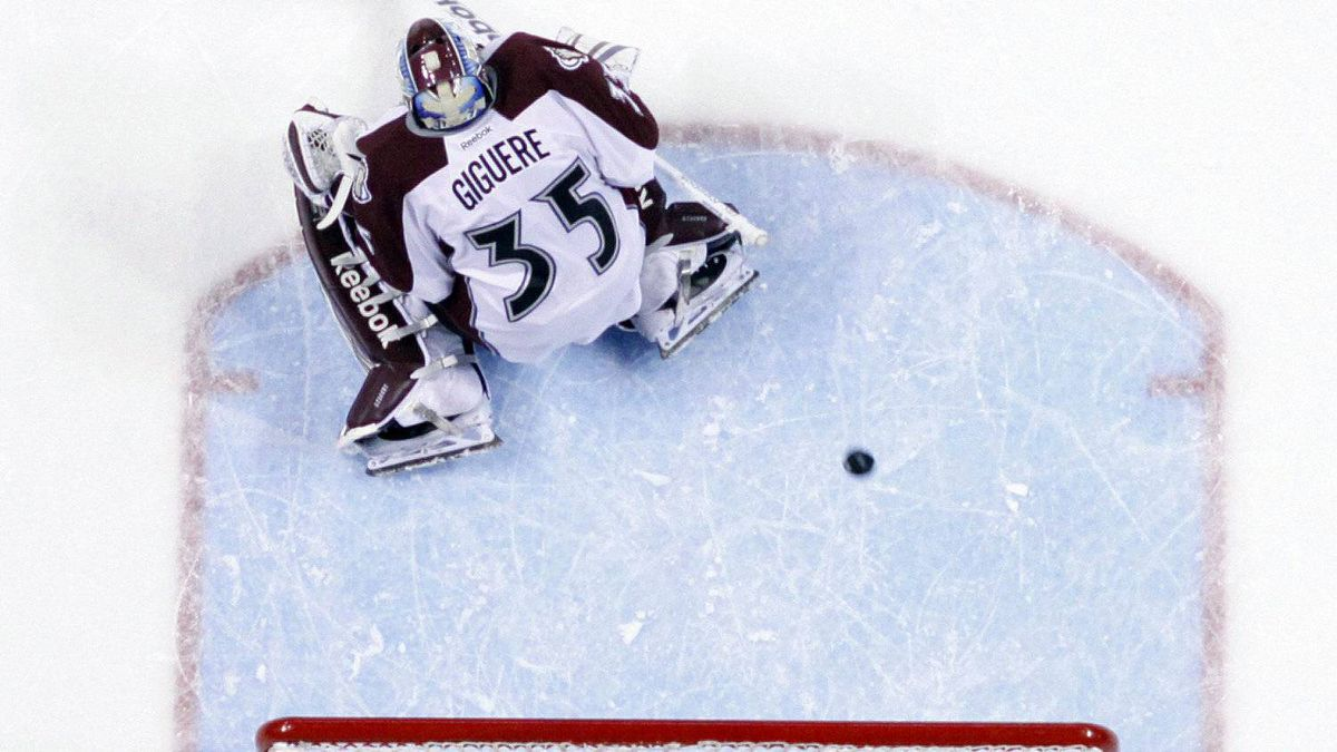 A shot by St. Louis Blues' Patrik Berglund, not shown, slips past Colorado Avalanche goalie Jean-Sebastien Giguere for a goal during the first period of an NHL hockey game Saturday, Jan. 7, 2012, in St. Louis. The Blues won 4-0. (AP Photo/Jeff Roberson)