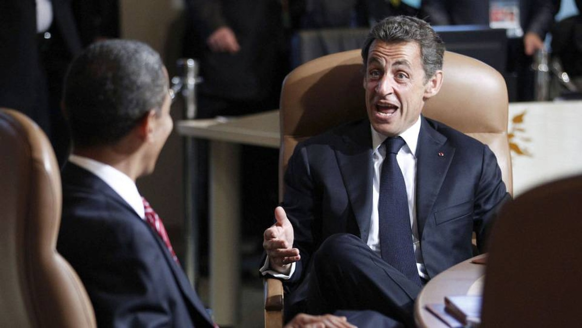 U.S. President Barack Obama listens to France's President Nicolas Sarkozy as the leaders of the G8 sit down for their first working session of the final day at the G8 Summit in Huntsville, Ont.