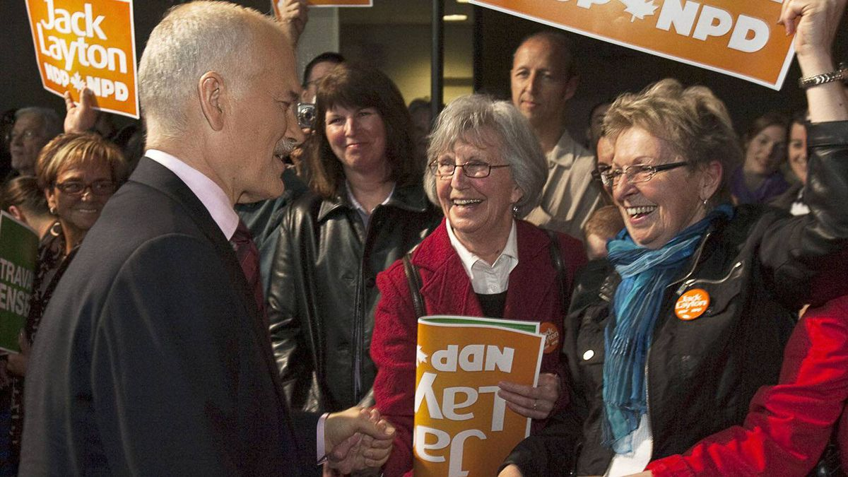 NDP Leader Jack Layton is greeted by supporters at a campaign rally at Ecole secondaire du Versant in Gatineau, Que.