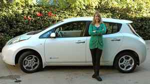 Monica Horan Rosenthal and her Nissan Leaf.