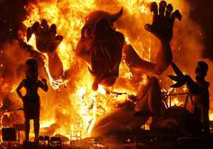 Effigies burn during the finale of the Fallas festival, which welcomes spring and honours Saint Joseph's Day, in Valencia in the early hours of March 20, 2012.