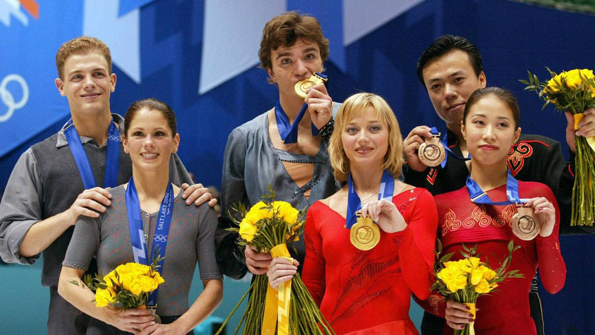 Russians Elena Berezhnaya and Anton Sikharulidze (gold) (C), Canadians Jamie Salé and David Pelletier (silver) (L), and Chinese Xue Shen and Hongbo Zhao (bronze) celebrate on the podium after their pairs program at the Olympic Ice Center, 11 February 2002 during the XIXth Winter Olympics in Salt Lake City, Utah.