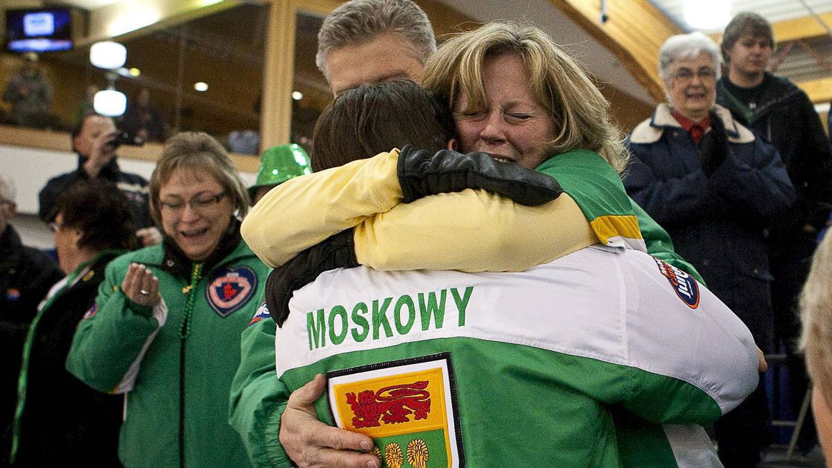 Team Saskatchewan's skip Braeden Moskowy hugs his mother Wenda Moskowy after winning the final of the men's Canadian Junior Curling Championships in Calgary Feb. 6, 2011. Team Saskatchewan beat Team Ontario 8-7 in an extra end and remained unbeaten in the tournament.