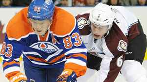 Colorado Avalanche's Bryan Allen, right, trips the Edmonton Oilers' Ales Hemsky during first period NHL hockey action in Edmonton on Friday, December 9, 2011. THE CANADIAN PRESS/John Ulan