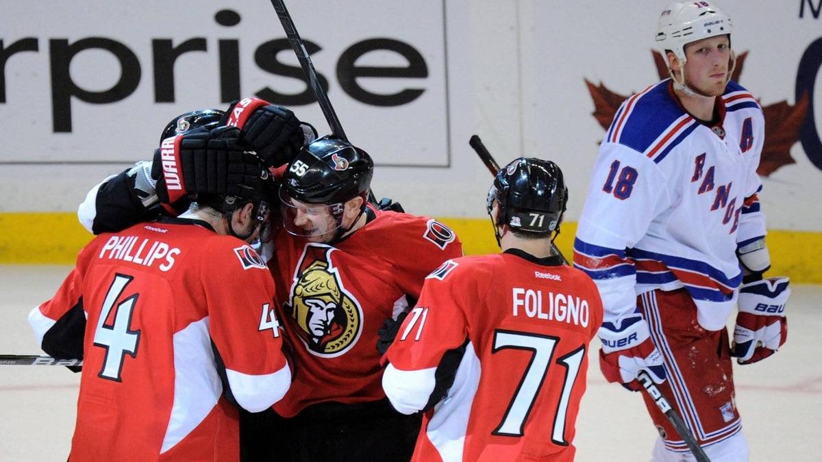 Ottawa Senators' Sergei Gonchar, centre left, celebrates his goal with teammates as New York Rangers' Marc Staal, right, skates past in Ottawa on Wednesday, April 18, 2012.