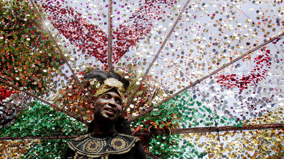 A performer dances in the street parade at the annual Notting Hill Carnival in central London August 29, 2011.