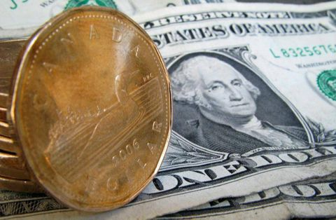 Loonie closes slightly higher ahead of heavy slate of economic data