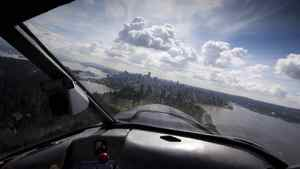Greg MacDougall CEO of Harbour Air flies his float plane in for a landing in Vancouver's harbour front May 17, 2011.
