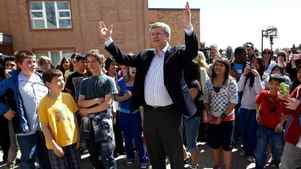 Conservative Leader Stephen Harper gestures while talking with children after casting his ballot at a polling station in a school in Calgary, Alberta May 2, 2011.