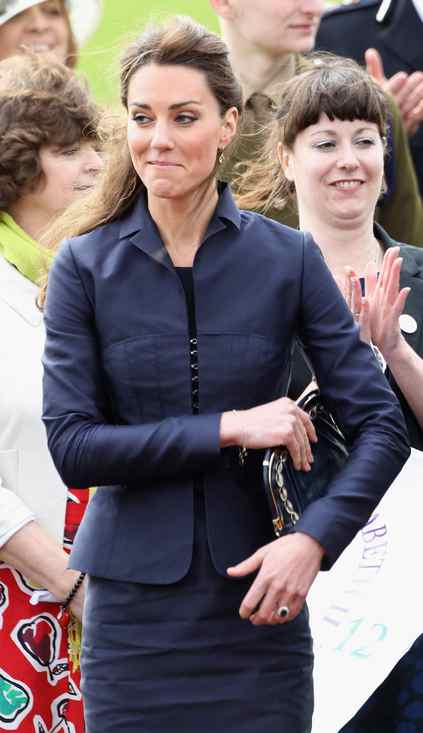 Kate Middleton laughs during a visit to Whitton Park on April 11, 2011 in Darwen, England. With less than three weeks to go until the Royal Wedding Prince William and Kate Middleton are making one of their final public appearances.