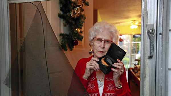 Carol Lalonde holds an an urn shaped like a hockey puck containing ashes of her late husband Laurence, similar to one she had stolen from her home in in Delta, B.C., on Christmas Eve.