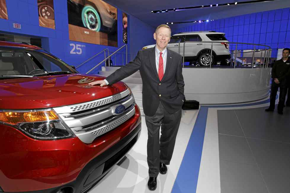 Ford CEO Alan Mulally poses at the Ford display at the North American International Auto Show in Detroit