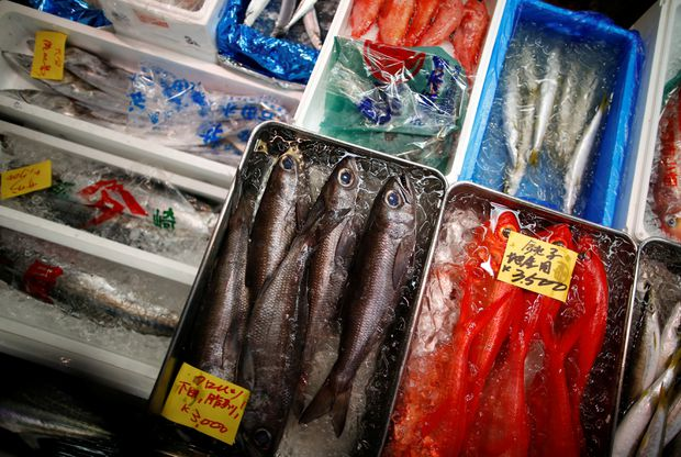 Protests and mourning as historic Tokyo fish market closes