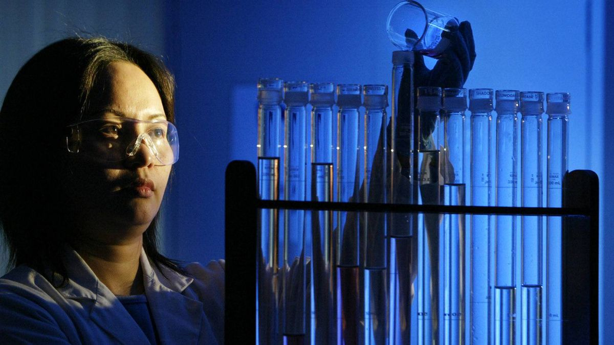 A researcher mixes a chemicals at QLT labs in Vancouver in this file photo.