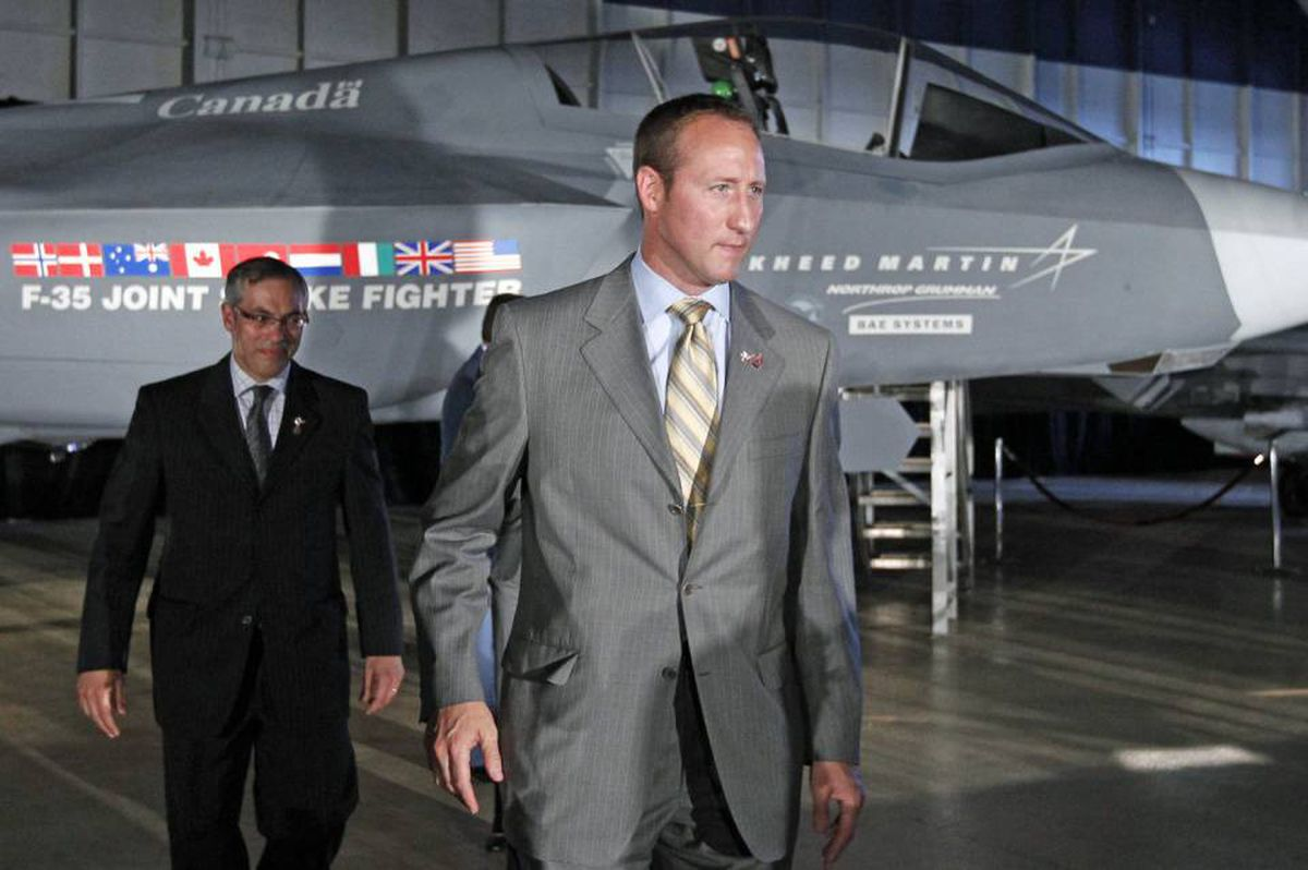 Defence Minister Peter MacKay and Industry Minister Tony Clement walk past a F-35 Joint Strike Fighter mock-up during a procurement announcement in Ottawa on July 16, 2010.