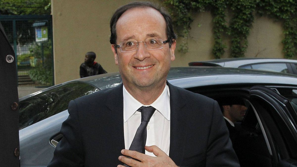 France's newly-elected President Francois Hollande arrives at his apartment in Paris May 7, 2012, a day after the French presidential election.