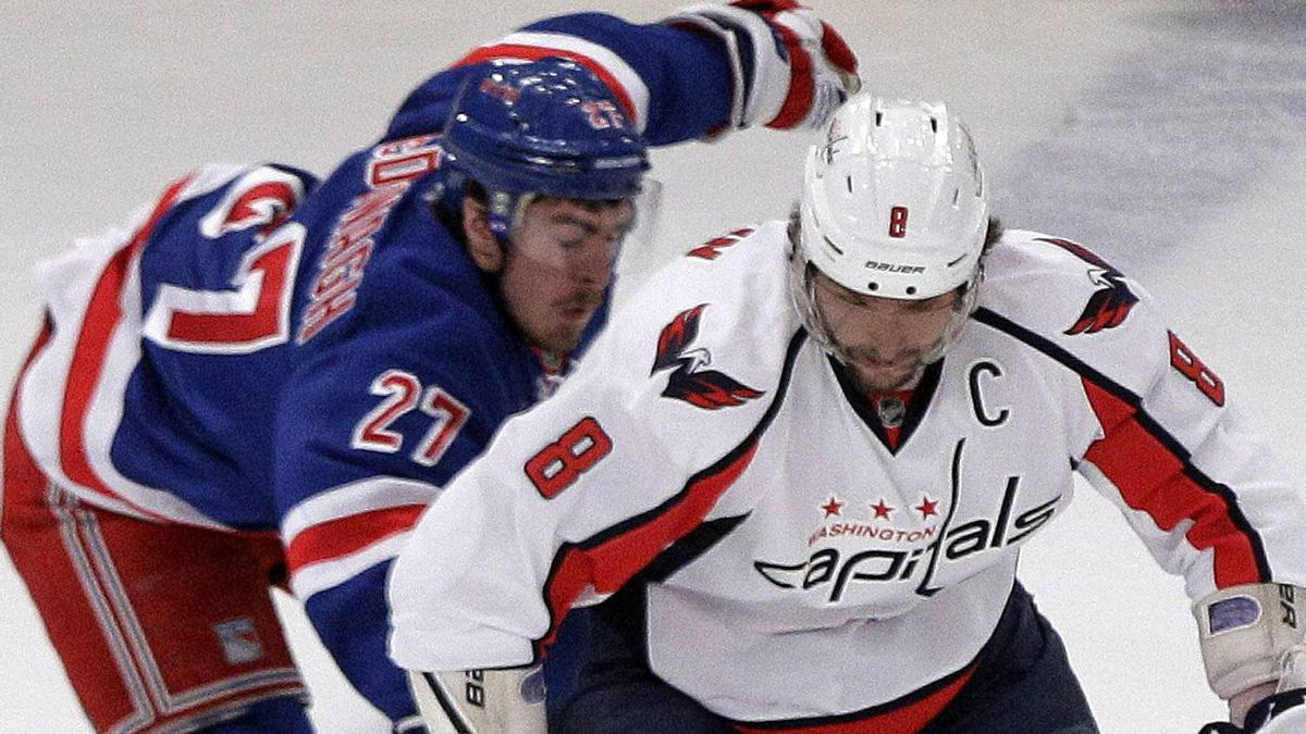New York Rangers' Ryan McDonagh (27) fights for control of the puck with Washington Capitals' Alex Ovechkin (8), of Russia, during the first period. (AP Photo/Frank Franklin II)